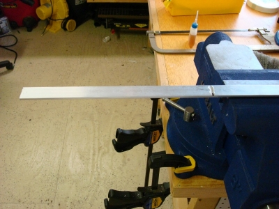 Clamp aluminum in vice, and cut to length